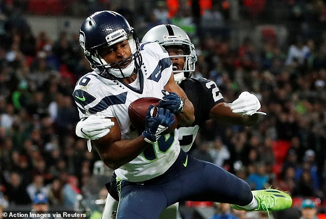 Ryler Lockett keeps his hands on the ball as he brings in a catch for a Seahawks touchdown