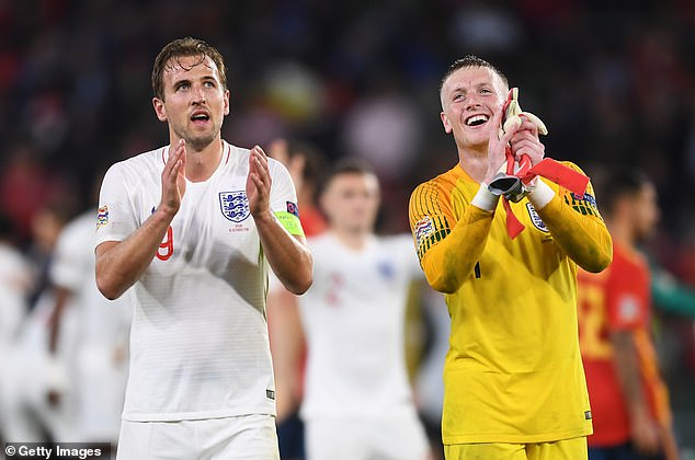 Harry Kane and Jordan Pickford applaud the travelling England fans on the final whistle