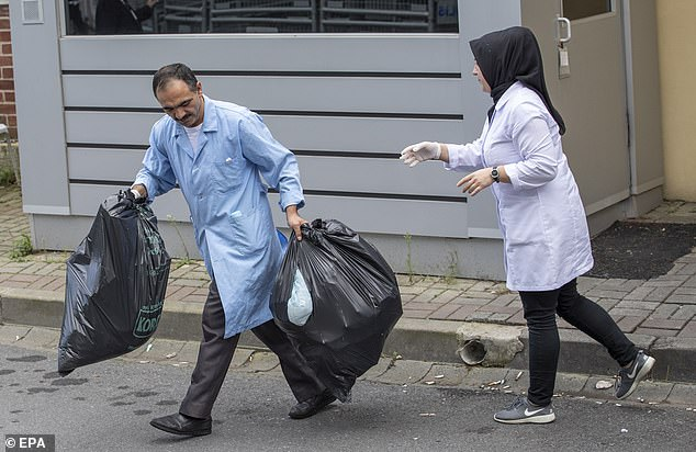 Throwing out the trash: The bags were taken out after the nine-hour overnight visit by Turkish investigators