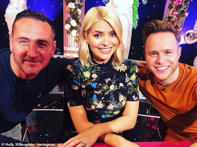 Here come the boys! Holly's picture with Will Mellor and Olly Murs filming Celebrity Juice racked up 38,000 likes, with John one of the fans who appreciated the snap