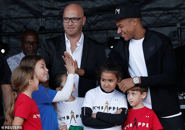 The PSG striker high fives a young girl as he enjoys a return to his hometown on Wednesday
