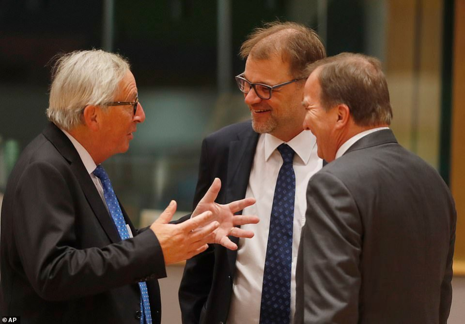 Jean-Claude Juncker (left) was deep in conversation with Finland Prime Minister Juha Sipila (centre) and Swedish Prime Minister Stefan Lofven (right)
