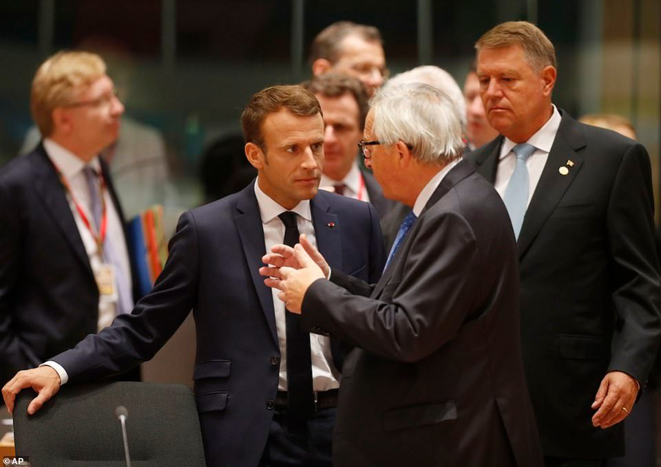 Emmanuel Macron (pictured left with Mr Juncker today) has said he is still hopeful of a deal - but the French government yesterday published a draft law making clear Britons will need visas to visit the country if there is no agreement