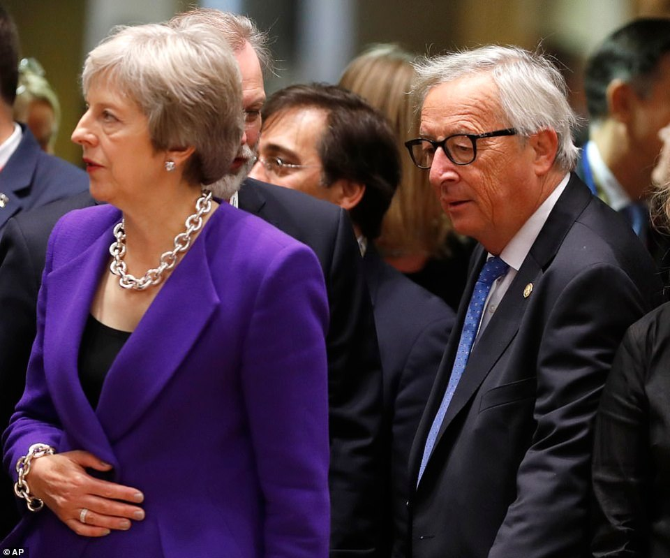 The body language between Mrs May and Jean-Claude Juncker (pictured right) has been closely watched during the gathering