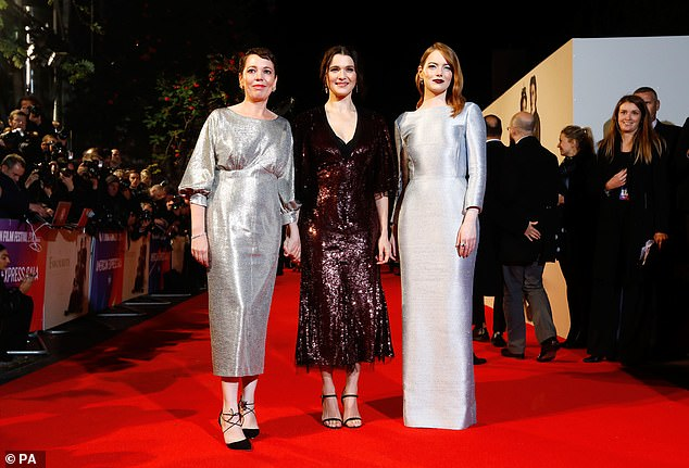 Leading ladies: Olivia joined forces with her co-stars Rachel Weisz and Emma Stone as they descended on the red carpet among the A-list crowd