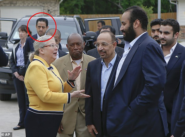 Maher Abdulaziz Mutreb,reportedly now being sought by Turkish authorities for questioning over Khashoggi's disappearance, can be seen in the background as Crown Prince Mohammed bin Salman (front right) visits a Habitat for Humanity event in Houston in April