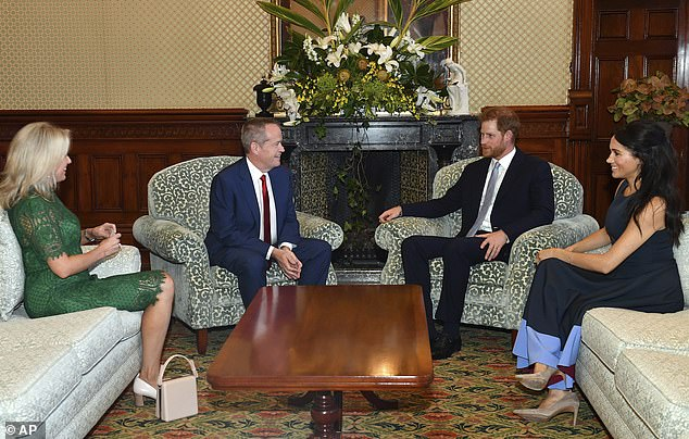 Evening: The Duchess of Sussex wore the same Roksanda dress as she joined Prince Harry to meet Australia'sopposition leader Bill Shorten and his wife Chloe Shorten at Admiralty House, Sydney. However Prince Harry changed into a suit and tie for the occasion