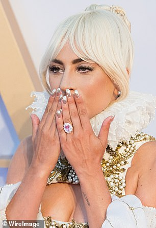 Incredible: The gemstone in the center of Lady Gaga's engagement ring could either be a diamond or a sapphire