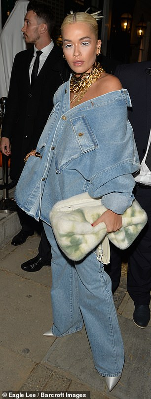Saucy:Sexily showing off her bare skin, the I Will Never Let You Down hitmaker nailed her double denim look with her off-the-shoulder shirt paired with jeans