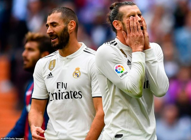 Karim Benzema and Gareth Bale (right) show their disappointment after Real Madrid endured another disappointing result