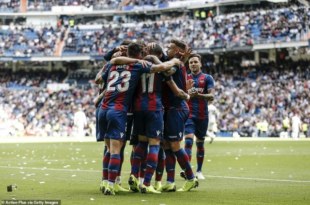 The jubilant Levante players celebrate after Jose Luis Morales' goal put them in front against Real Madrid