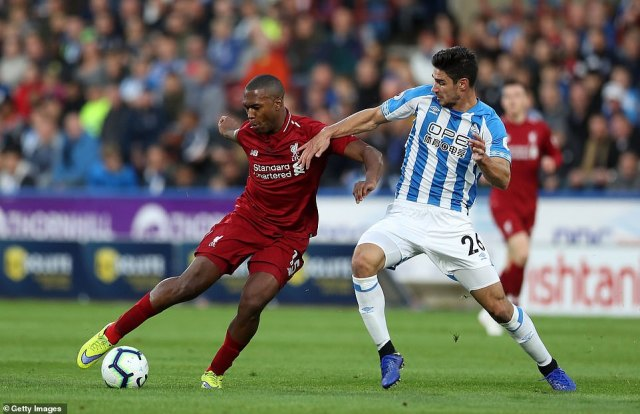 Liverpool's Daniel Sturridge is tackled by Christopher Schindler of Huddersfield during the first half of the league clash