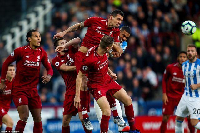 Liverpool defender Dejan Lovren and Mathias Zanka Jorgensen challenge for the ball in the air at theJohn Smith's Stadium