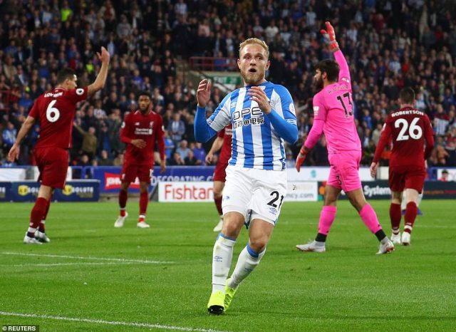 Huddersfield midfielder Pritchard reacts after his goal was ruled out for offside during the first 45 minutes on Saturday