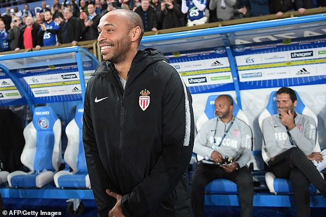 Henry smiles in the dugout before the clash betweenStrasbourg and Monaco on Saturday