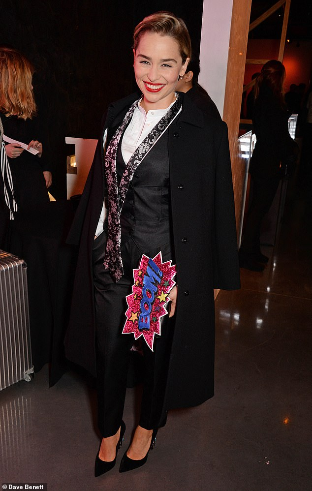 Glamorous:Her smart outfit consisted of a long black coat and a white crisp shirt which she teamed with a floral silver tie - left stylishly undone