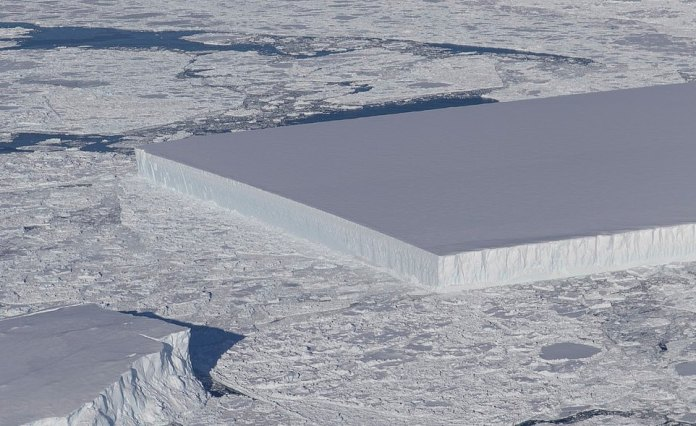The original 'monolith'rectangular berg was spotted near the Larsen C ice shelf, and NASA experts believe it the sharp edges are evidence it may have recently broken off the shelf