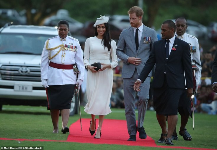The couple walk along a red carpet at the city centre's Albert Park to watch the Veirqaraqaravi Vakavanua ceremony, which embodies Fijian cultural identity and heritage
