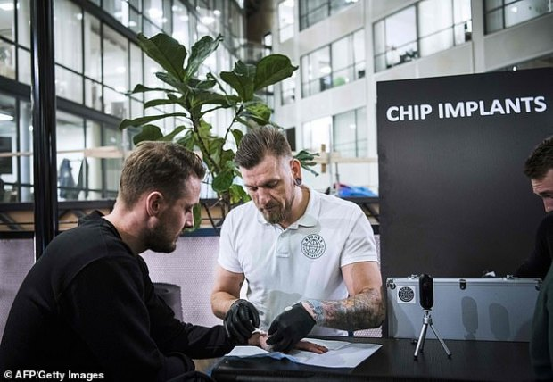 Jowan Ãsterlund (right) is a tattooist and body piercing specialist turned biohacker, who has chipped most people in the world. An electronic implant is inserted under the skin to replace keys, business cards and train tickets