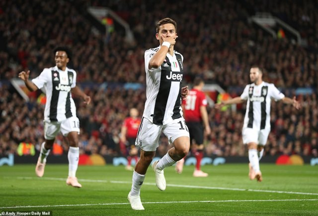 Dybala celebrates in typical fashion in front of the home supporters after his 17th minute goal at Old Trafford
