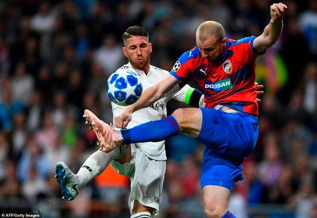 Viktoria Plzen forward Michal Krmencik challenges for the ball alongside Sergio Ramos during the first half