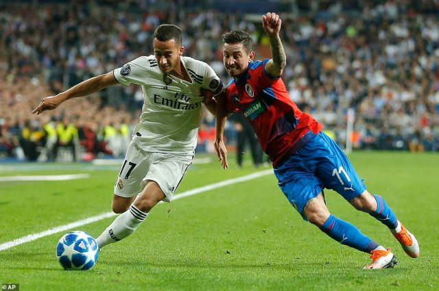 Real Madrid Lucas Vazquez looks to hold off the challenge of Viktoria Plzen'sMilan Petrzela on the touchline