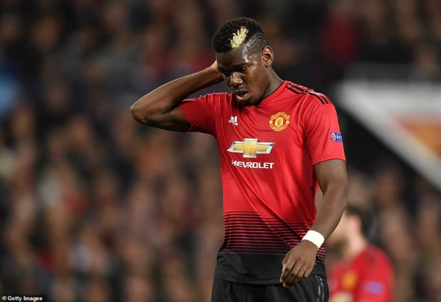 Pogba shows the strain after a frustrating first half for United where they struggled to create clear-cut chances