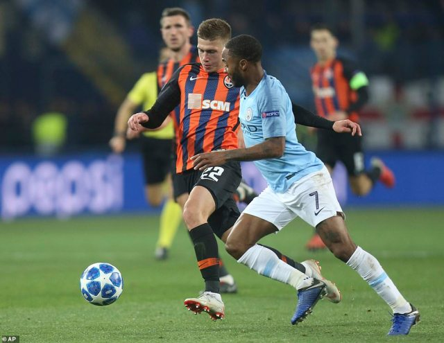 Manchester City's Raheem Sterling andShakhtar Donetsk'sMykola Matviyenko battle for ball during Champions League tie