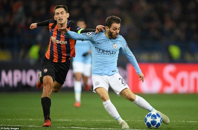 Bernardo Silva of Manchester City scores his team's third goal of the game in the 70th minute to put his side in control