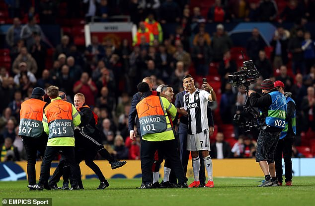 Cristiano Ronaldo posed for a selfie with a pitch invader at Old Trafford on Tuesday evening