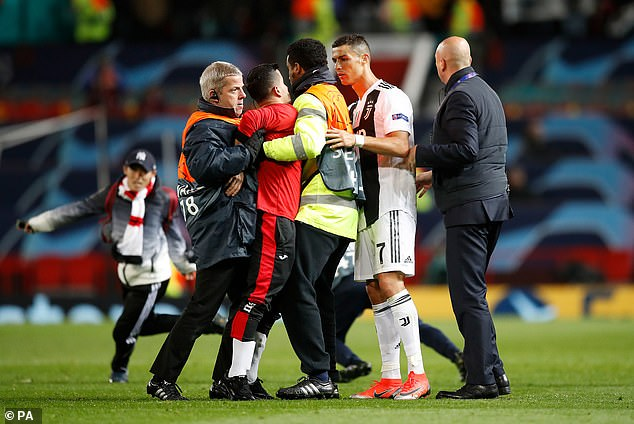 The trespasser was eventually caught and escorted off the Old Trafford pitch