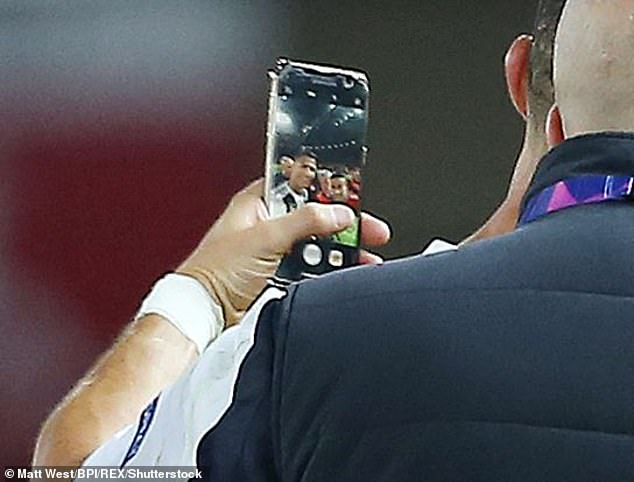 The United fan could face a lifetime ban but has this souvenir saved on to his phone
