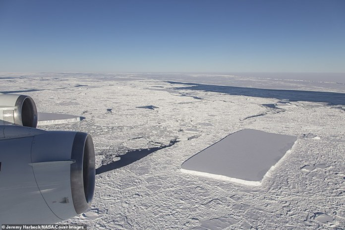 Just past the original rectangular iceberg, which is visible from behind the outboard engine, IceBridge saw another relatively rectangular berg and the A68 iceberg in the distance.