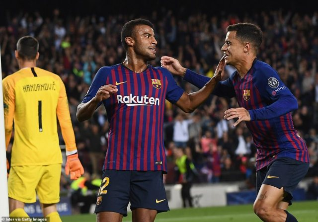 Rafinha (left) celebrated after breaking the deadlock and putting Barcelona a goal up against Inter Milan at the Nou Camp