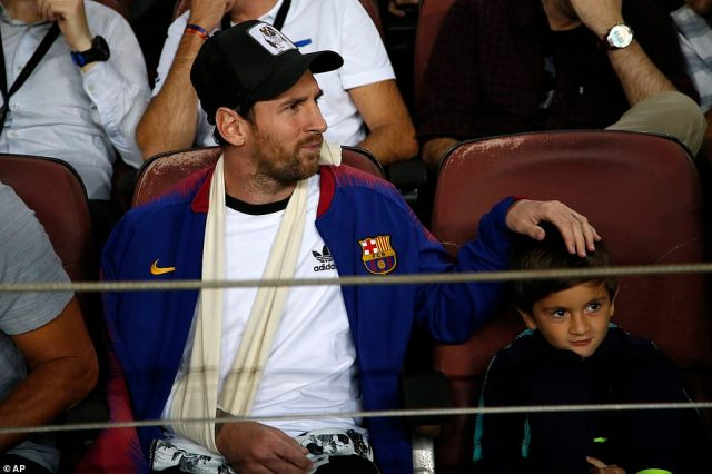 Lionel Messi is sidelined with a broken arm and watched the game with his son in the stands at the Nou Camp