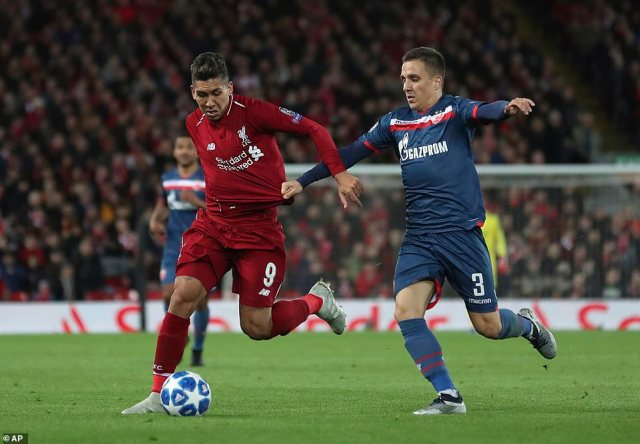 Firminohas his shirt pulled by Red Star Belgrade's Branko Jovicic during the Group C clash at Anfield on Wednesday evening