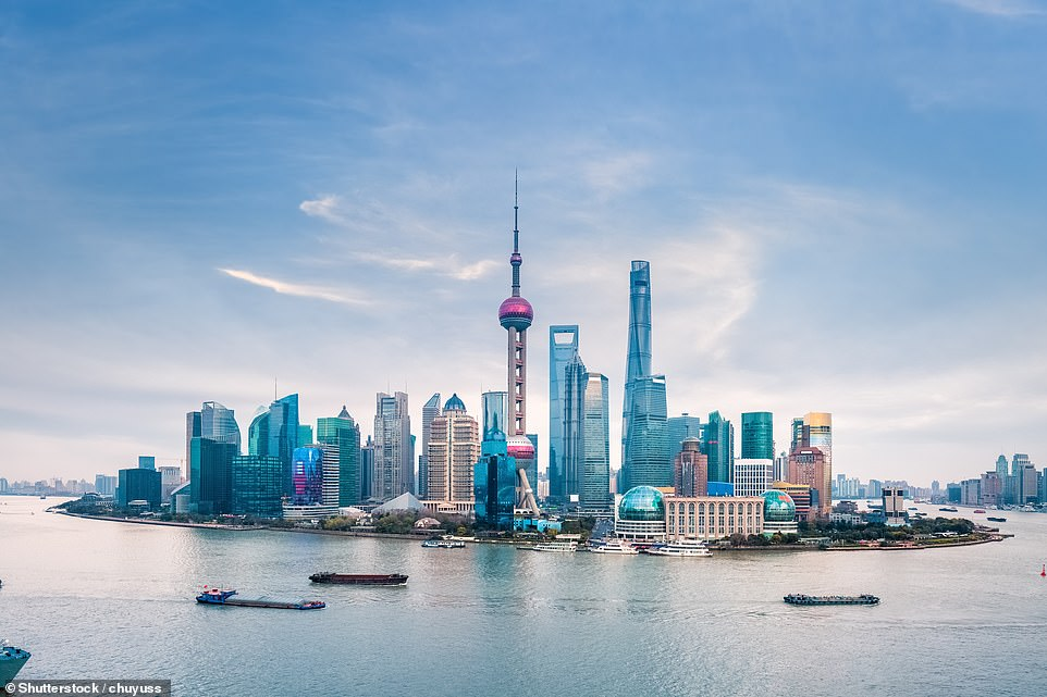 """The skyscrapers of Shanghai, this time in a shot showing the Huangpu River running around them. The name of the city of Shanghai means """"on the sea"""". This is due to the location of Shanghai on the Yangtze River Delta near the South China Sea"""