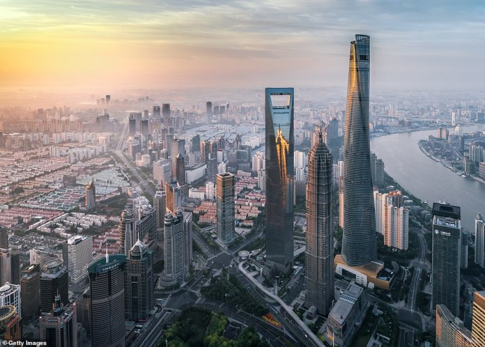 The Lujiazui District of Shanghai is considered the financial district of the city. Here is the bizarrely shaped Shanghai World Financial Center (the second tallest building in this setting), compared to the shape of a bottle opener