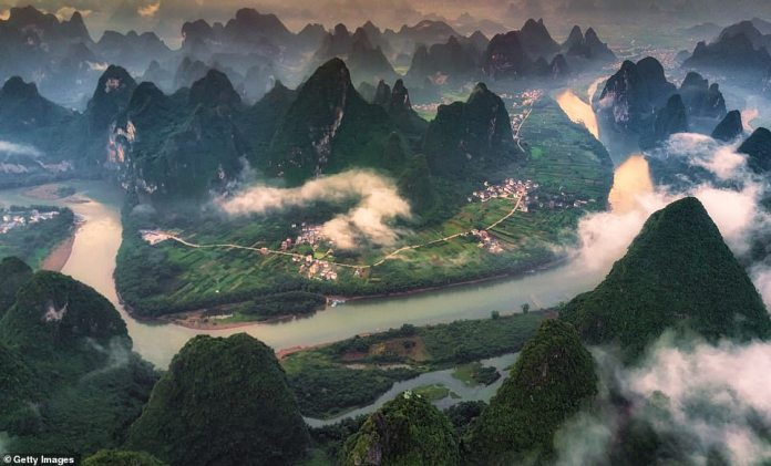 The Li River meanders around the green hills in Yangshuo County. We just could not resist showing this scenery twice