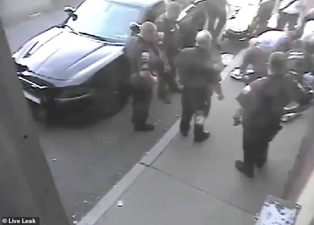 Another section of footage taken outside the police station shows Kearse collapsing and receiving CPR on the sidewalk