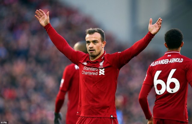 Xherdan Shaqiri receives the acclaim of the Kop after scoring his first goal for Liverpool as they went back top of the table