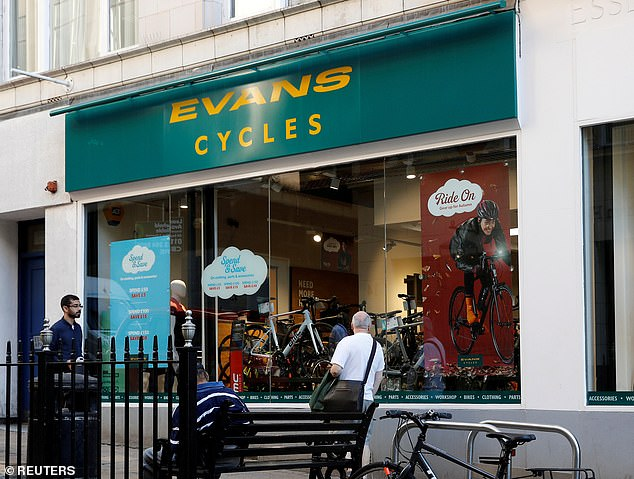 Jobs threatened: Evans Cycles, which operates 62 stores in the UK, employs 1,300 people. New owner Sports Direct said half of the deal could be closed