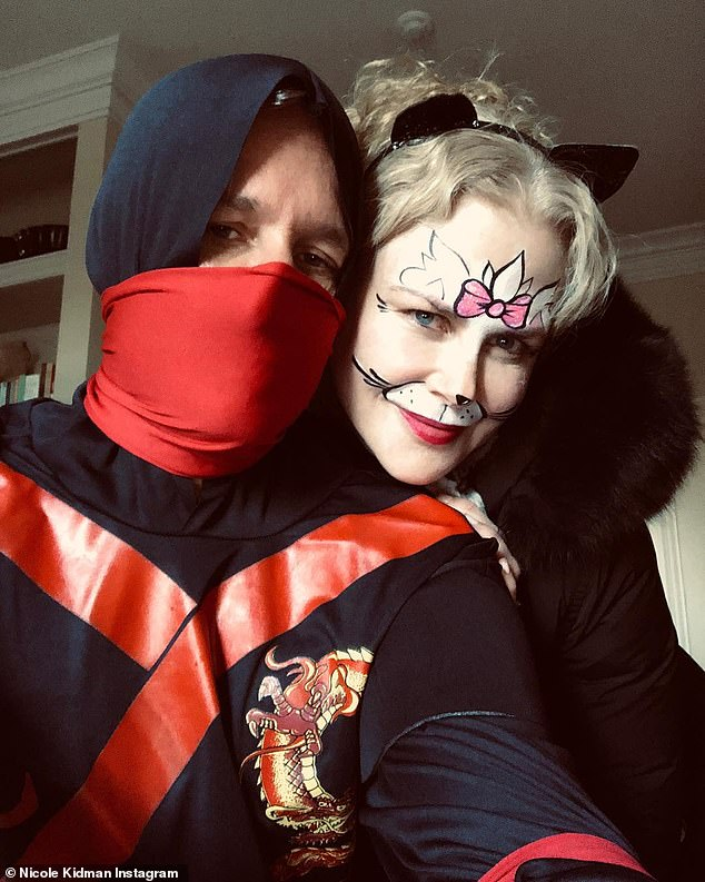 Fun couple:Nicole Kidman dressed up in face paint and a black coat as she posed with Keith Urban who seemed to be a Ninja warrior