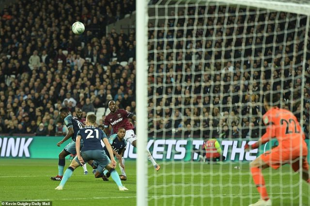 Michail Antonio (No 30) curls a shot towards the Tottenham goal as the hosts look to get themselves back in the game