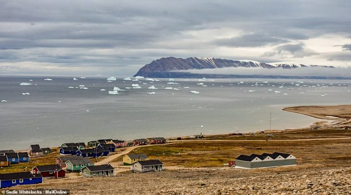 A view of the bay off Qaanaaq with small icebergs in the water