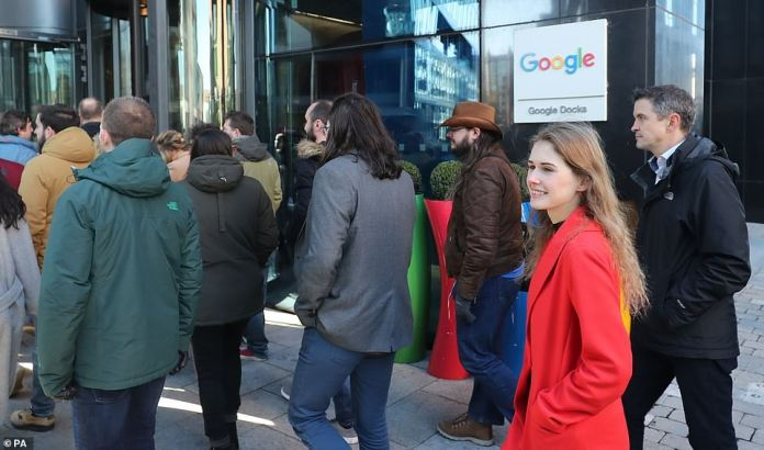 Men and women walk out of the Dublin, Ireland Google office on Thursday in protest of the handling of sexual assault claims