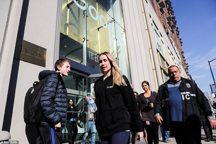 A few New York Google employees trickle out of the office on Thursday during the global walkout protest