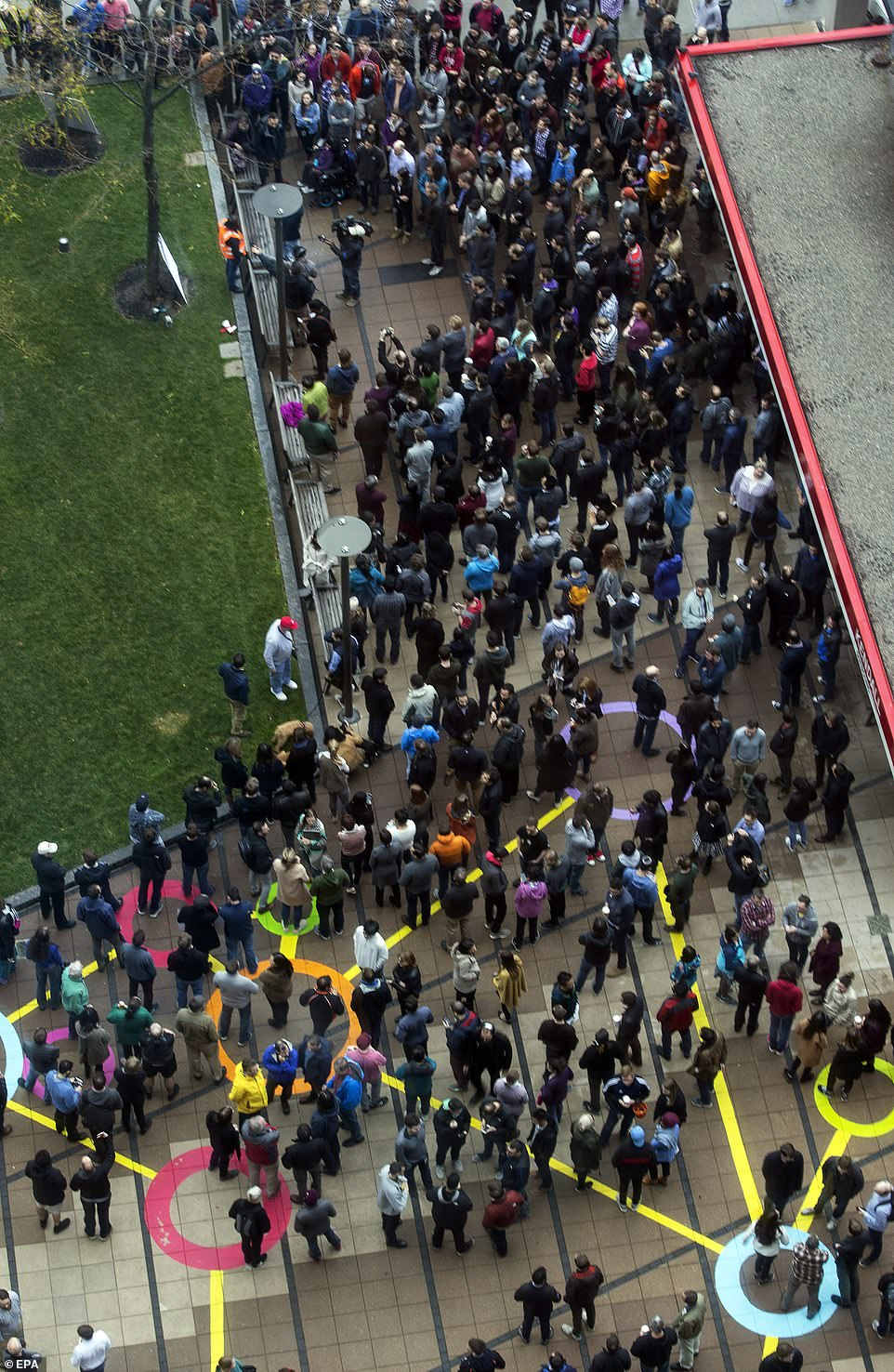 Google Inc. employees strike when they call for a secure job outside Kendall Square MBTA Station in Cambridge, Massachusetts