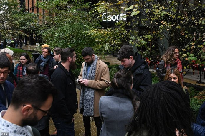 London Google employees wait outside during the time leading up to a walkout in protest of company culture on Thursday