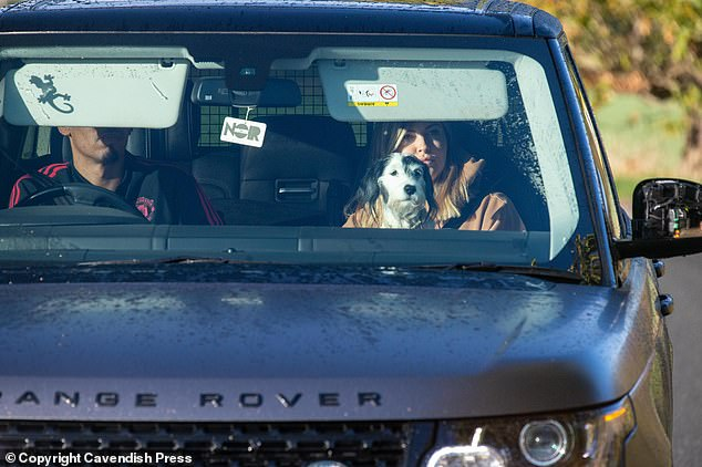 Chris Smalling comes on Friday with Ms. Sam Smalling and her dog Miley for training